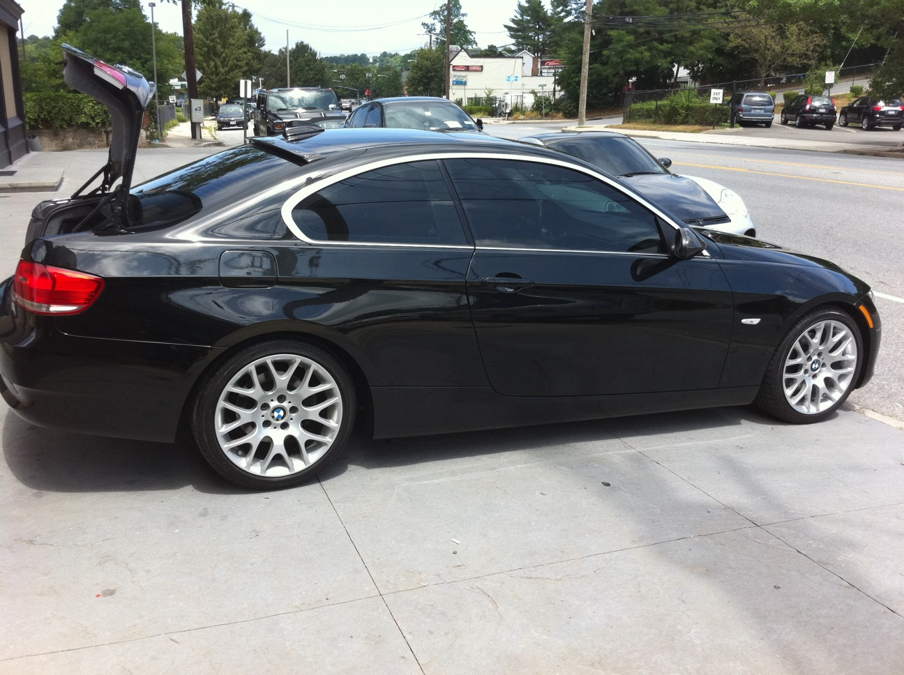 Can anyone post pics of black e92 with tinted windows for 20 percent window tint