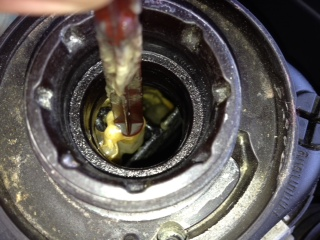 What is this crap in my coolant reservoir