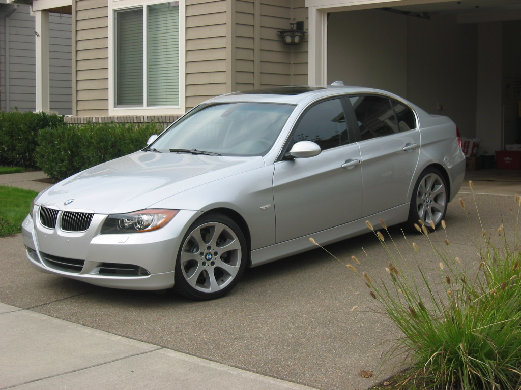 Silver 330i with 35 window tint and bumper plugs for 14 window tint